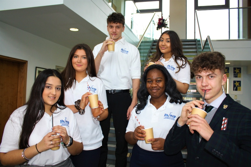 A picture of a group of St Dominic's Grammar School students showing the straws they are selling as part of the Young Enterprise project.