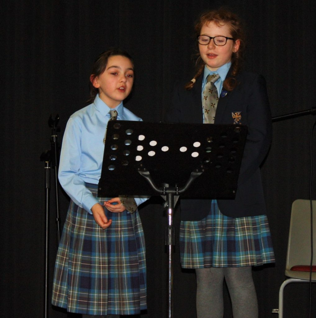 Two pupils singing at St Dominic's Grammar School