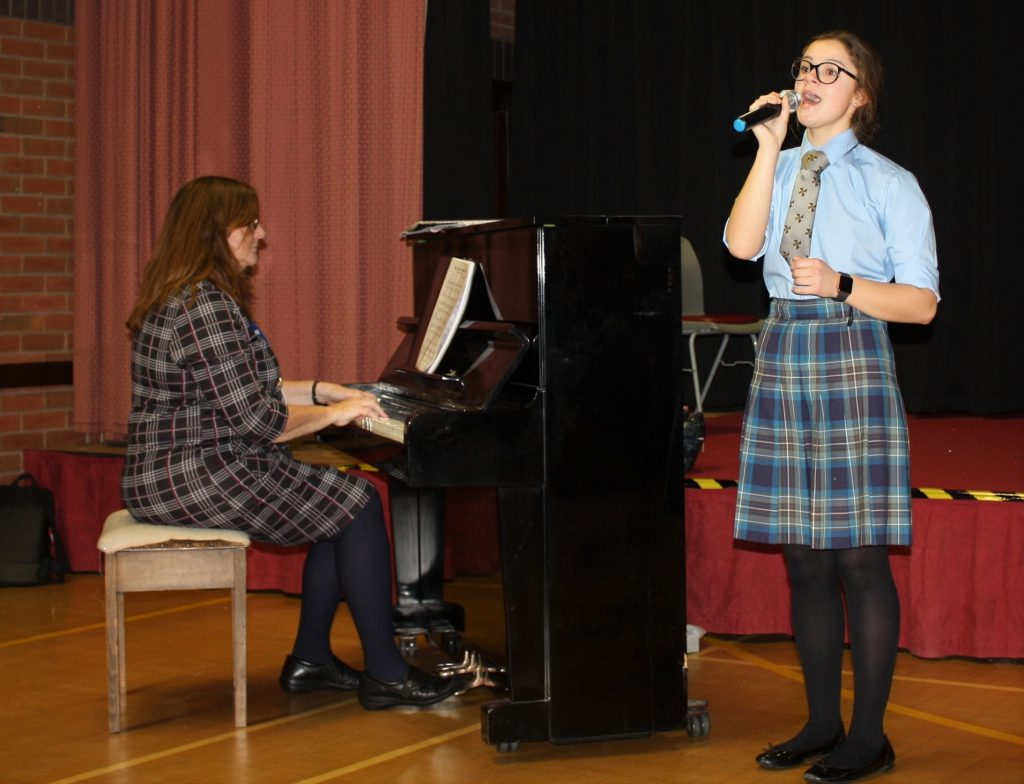 A pupil of St Dominic's Grammar School performing at a music concert